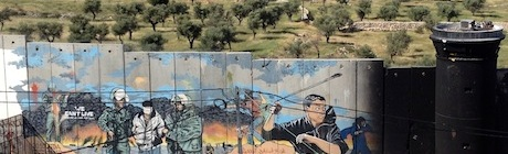 The wall stops people living in Aida refugee camp from accessing the green lands behind.