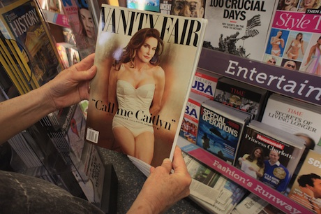 New York, United States. 9th June 2015 -- A reader browses a copy of the latest Vanity Fair magazine at a newsstand in New York, featuring Caitlyn Jenner, formerly Bruce Jenner on the cover and in a photo spread inside. -- Vanity Fair magazine features Caitlyn Jenner, formerly Bruce Jenner, on the cover and in a photo spread inside. The issue hit the stands today although promotion for the issue started several weeks ago.