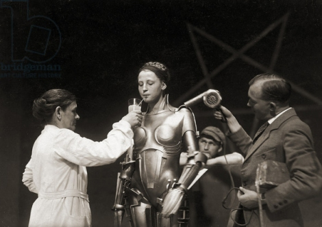 "DGC940170 Brigitte Helm (1906 – 96) in costume as ""Maria"" on the set of the film Metropolis, 1927 (b/w/ photo) by German Photographer, (20th century); Private Collection; (add.info.: Brigitte Helm (1906 – 96) was a German actress, best remembered for her dual role as Maria and her double, the Maschinenmensch, in Fritz Lang's 1927 silent film Metropolis.